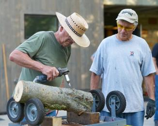 Drilling a log. By Kristine Murawski
