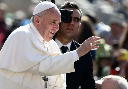 Pope Francis waves to worshipers upon his arrival for the weekly general audience on May 8, 2019 at St. Peter's square in the Vatican.