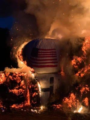 The Biden-Harris hay bale display in Dalton, Massachusetts after it was set on fire Friday night.