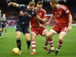 Ross County's Craig Curran (left) is closed down by Andrew Considine (centre) and Mark Reynolds