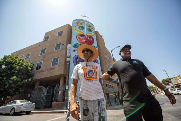 Renowned artist Kenny Scharf unveils towering mural on LA's Skid Row