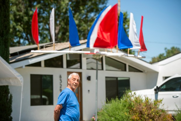 92-year old Jim Mangiaracina of Woodland Hills shows off sailboat-inspired July 4th decorations