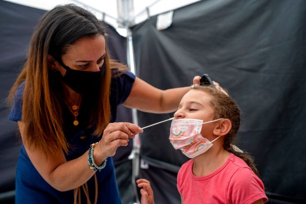 Amid coronavirus-fueled uncertainty, LAUSD back for 'first day' like no other