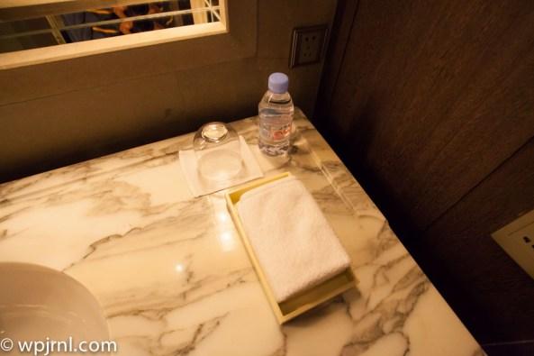 Park Hyatt Shanghai Diplomatic Suite - towels and water