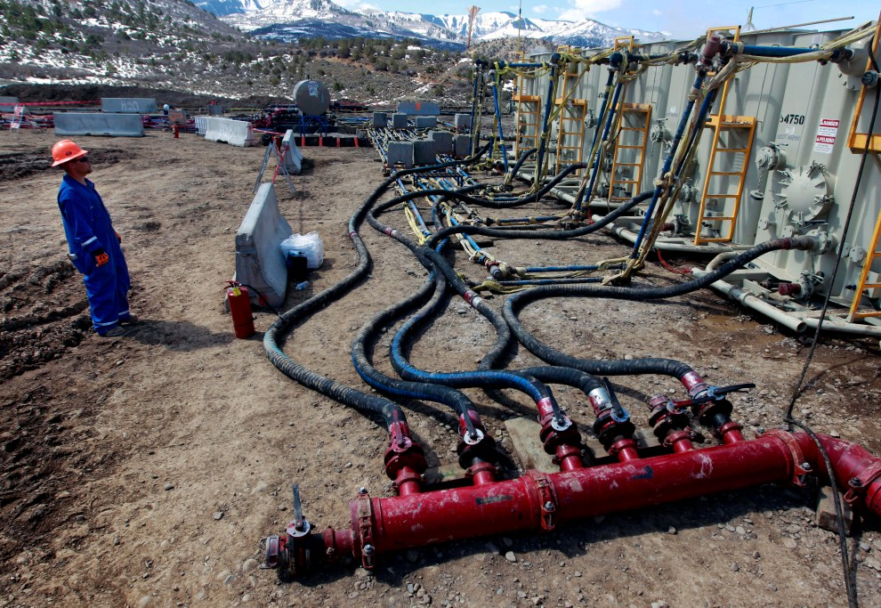FILE - A worker helps monitor water pumping pressure and temperature at an oil and natural gas extraction site in Colorado, March 29, 2013.A Trump administration national security official has sought help from advisers to a think tank that disavows climate change to challenge widely accepted scientific findings on global warming, according to his emails.