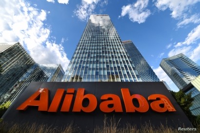 FILE - The company sign of Alibaba Group Holding Ltd is seen outside its headquarters in Beijing, China, June 29, 2019.