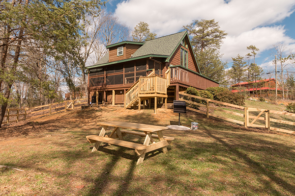 cabin on a hill side with a picnic area