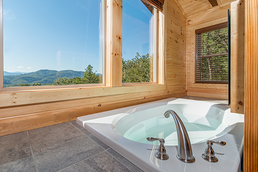 a jacuzzi tub with a view - canyon camp falls