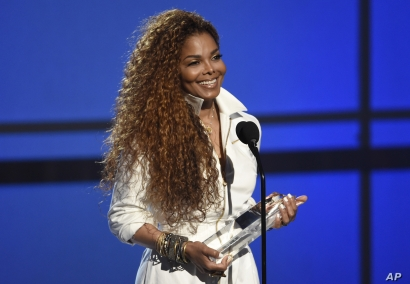 Janet Jackson accepts the ultimate icon: music dance visual award at the BET Awards at the Microsoft Theater on June 28, 2015, in Los Angeles.