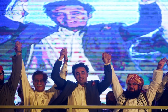 Chairman of Pakistan Peoples Party, Bilawal Bhutto Zardari , center,  joins hands with other opposition parties leaders during a protest in Karachi on July 25, 2019.