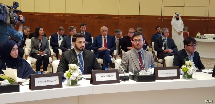 Afghan delegates inside the conference hall included Lotfullah Najafizada (2nd-R), the head of Afghan TV channel Tolo News, in Doha, Qatar, July 7, 2019. U.S special envoy Zalmay Khalilzad is seen center rear, with red tie. (A. Tanzeem/VOA)