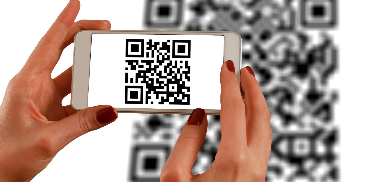 A phone being held above a QR code