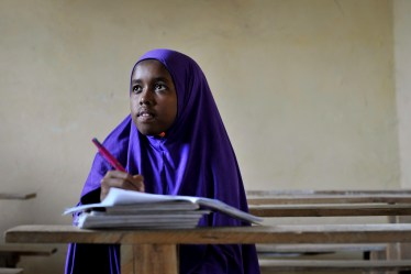 UN Photo - Girl studying at IDP camp in Somalia