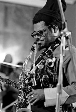 Rahsaan Roland Kirk playing a saxophone.