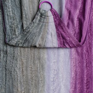 Flat image shot of the gray to purple graduation of color of the ring sling with purple rings.