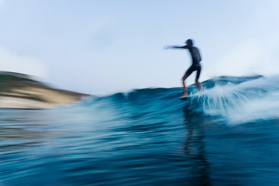 Local surfer in Sardinia photo by Andrea Bianchi