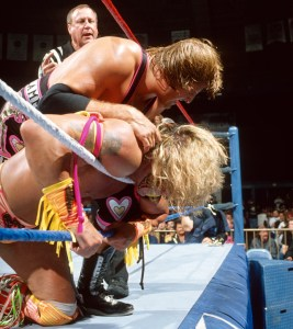 Owen Hart choking The Ultimate Warrior on 7/8 RAW.