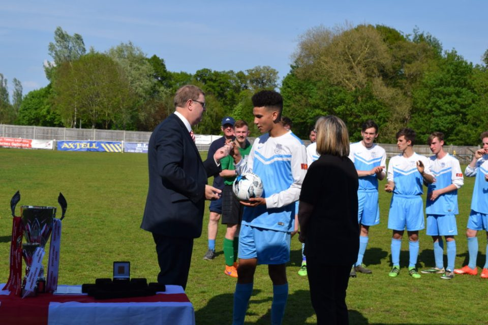 Michael Colfer, Fleet Town, Man of the Match, Receives the Match Ball from SPL Officials