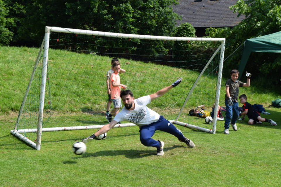 U7 Pirates Manager Rob Monks At Full Stretch In 'Beat the Goalie'