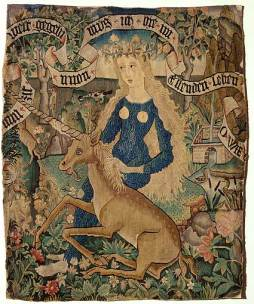 "Courtesy of Wikimedia: Description: ""Wildweibchen mit Einhorn"", ""Wild woman in blue titty dress with unicorn"", Kissenplatte, Strassburg, 76cm × 63cm,"