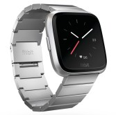 Product render of Fitbit Versa in 3 quarter view in silver metal links showing analog clock