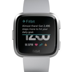 Product render of Fitbit Versa in front view showing Fitbit Now with Almost There chatter on screen