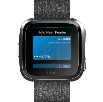 Product render of Fitbit Versa in front view with graphite aluminum body with Fitbit pay showing a card on screen