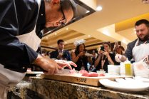 Chef Morimoto slices fresh tuna for us in The Mansion box seats.