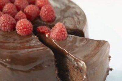 Image, iced chocolate cake with raspberries.