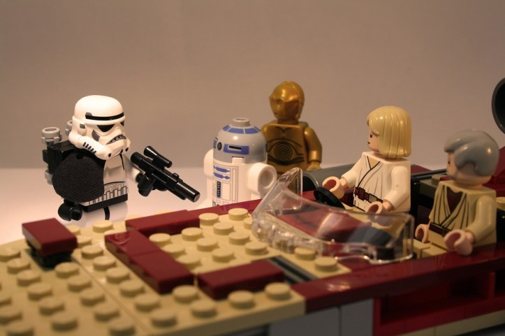 Image, Lego Luke Skywalker, Obi-Wan Kenobi and droids talk to a Stormtrooper.