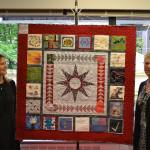 Image, Lynda Harris and Rosie Knighton with Write Limited 25th anniversary quilt.