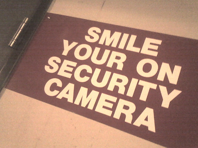 Image, Security sign with incorrect spelling.