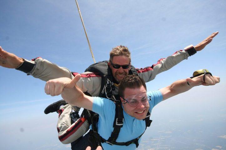 Image, Man skydiving, looking happy.