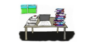 Image, books and papers stacked on desk.