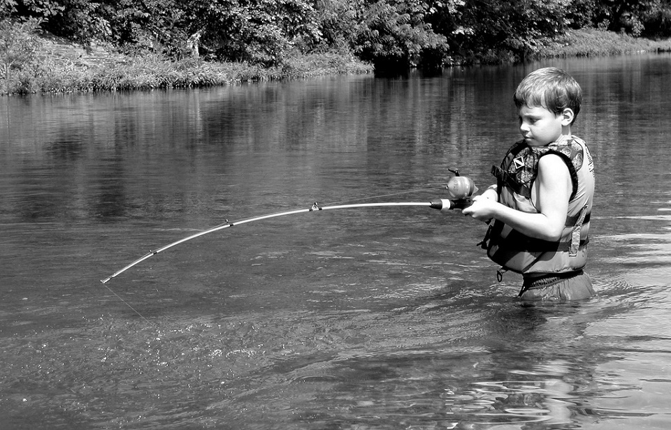 Image, hook your reader, boy fishing.