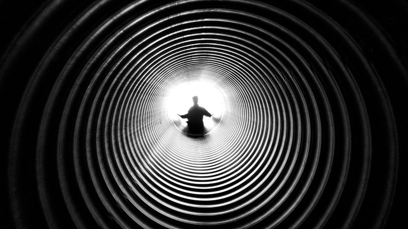 Image, Person sliding through vortex.