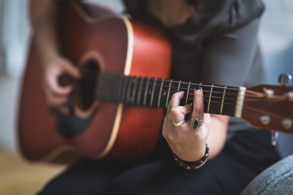 Image, Person practising guitar.