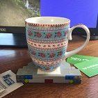 Image, patterned mug on a coaster made of lego