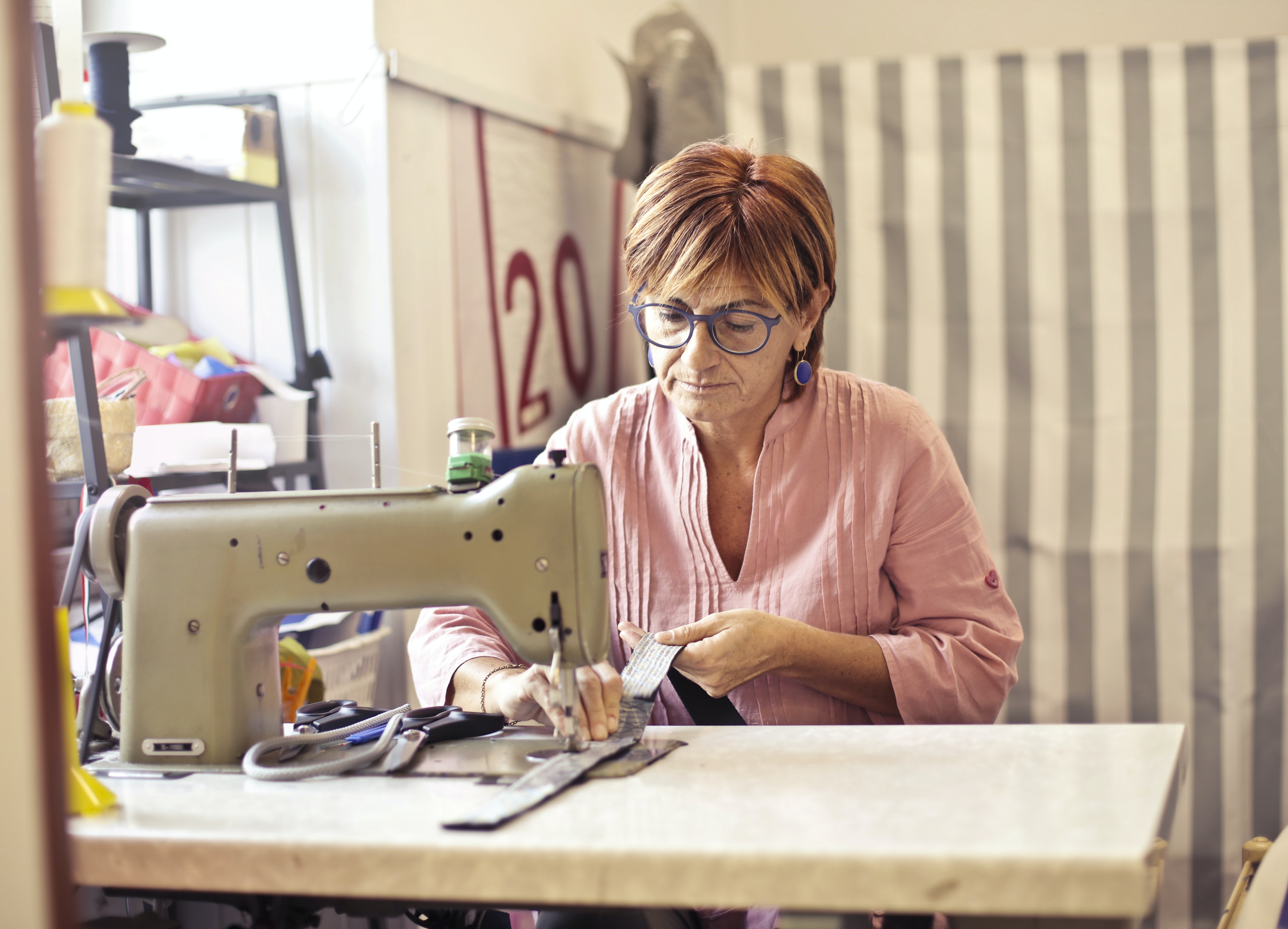 middle aged woman working on sewing machine