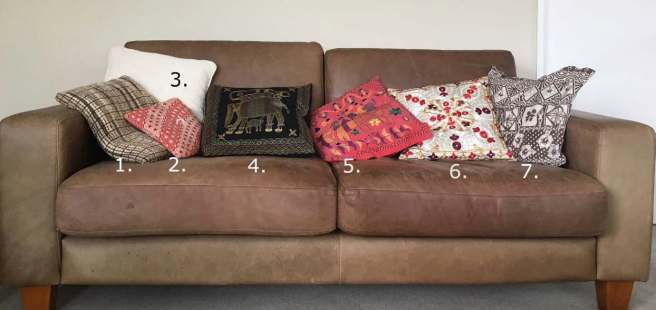 Couch with souvenir cushions from 5 countries