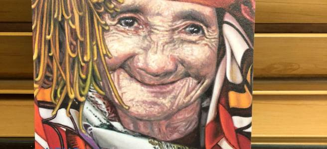 Reproduction of Hong Ilhwa painting of an old woman in colourful headdress smiling