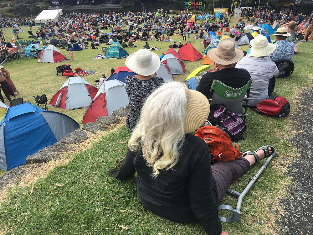 WOMAD festival crowd arriving in sunny Pukekura Park for a big performance in the TSB Bowl.