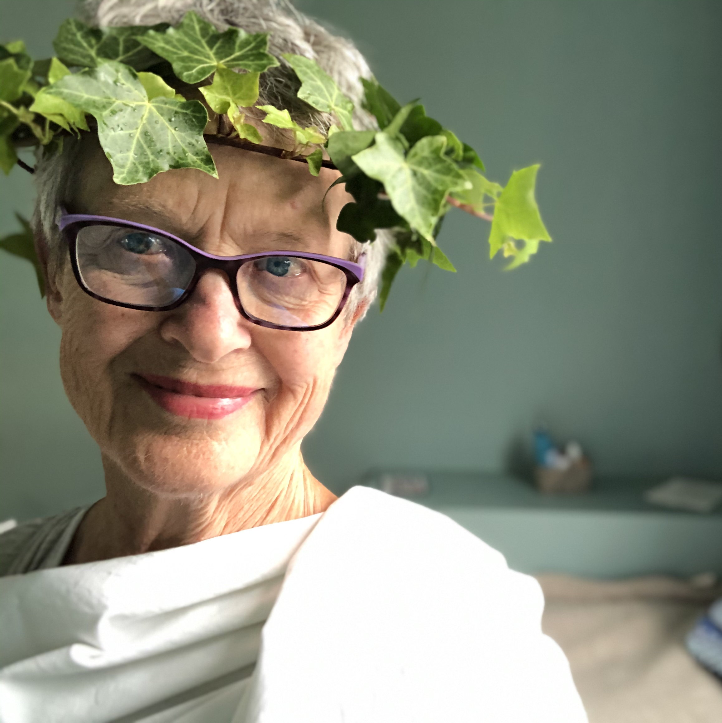 Rachel McAlpine with ivy crown wrapped in a sheet