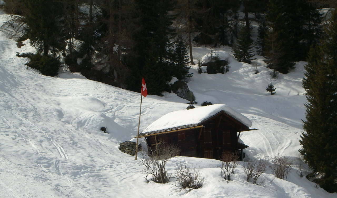 photo of swiss challet on snowy mountain side