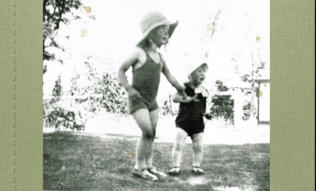 7-year-old girl leading toddler by the hand, black and white old photo