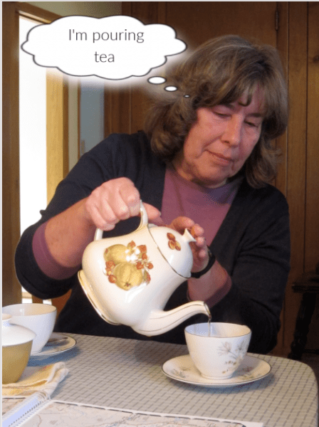 woman pouring tea is thinking, I'm pouring tea: mindfulness in action
