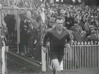Ron Barassi Snr enters the MCG