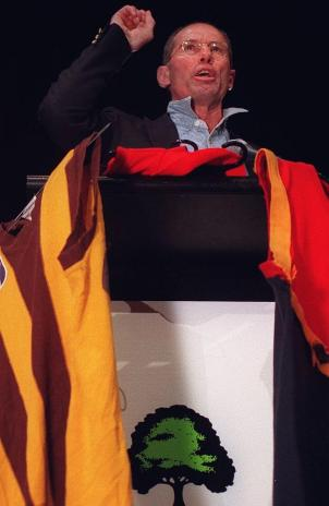 Don Scott at the pulpit standing against the Melbourne Hawks