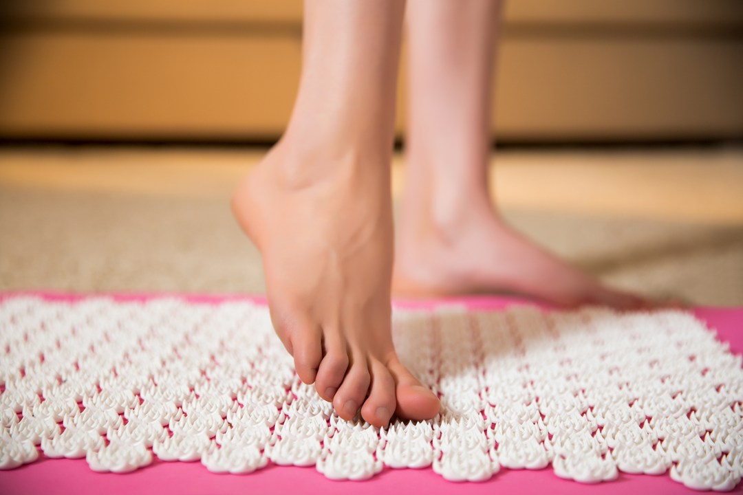 Ladies feet on an acupressure mat