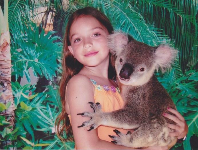 Australian girl holding a koala